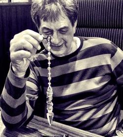 man holding pendulum