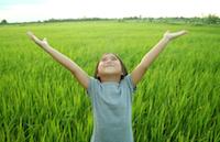 Reiki for kids girl in grass