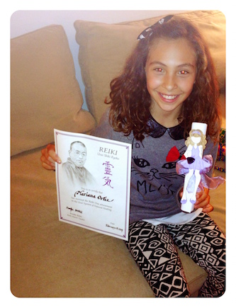 Mariana and her Reiki certificate