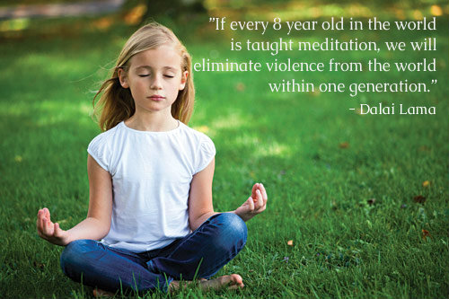 kid meditating and practicing reiki